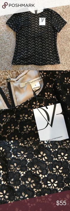 DVF Acorn Lace Top Black lace short sleeve top with nude liner. Beautifully made. Fitted with back zip closure. Never worn, new with tags. Looks amazing tucked into a skirt or with black leather pants. Perfect holiday party top! The sheath dress version of this top is sold out at Nordstrom (priced at $425). Diane Von Furstenberg Tops Blouses