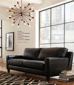 The #modern loft look is all about mixing styles! We love this fun #chandelier paired with the #classic couch and rug!