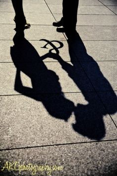 Engagement #shadow #kiss #yellow shoes #props #AKO Photography http://www.akophotography.com