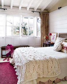 this space is so great! The awesome knit blanket at the end of the bed makes me sad that I can't have one because my cats will eat it though...