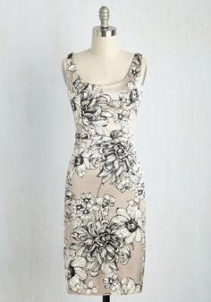 Receiving high honors for your smart and stylish insights, you rise for your speech in this sleek sheath dress. Fashioned with a pen-and-ink print of beautiful blooms atop a shining silver backdrop, this silky dress offers its own brilliant perspective on how to look lovely.