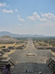 "Avenue of the Dead & Pyramid of the Sun (view from Pyramid of the Moon, Teotihuacan, Mexico - Teotihuacan is an enormous archaeological site in Basin of Mexico, 30 miles northeast of Mexico City, containing some of the largest Mesoamerican pyramids built in pre-Columbian Americas. The name means ""where man met the gods."" Teotihuacan is also known for its large residential complexes, and numerous colorful, well-preserved murals."