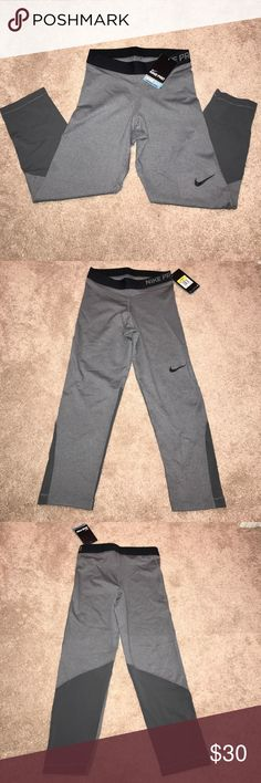 Women's NikePro Dri-Fit workout capris, gray, SM Women's NikePro Dri-Fit workout capris, gray, size small. These capris are meant to keep you cool during your workout, run, etc. These pants are NEW with the tags! Nike Pants Capris