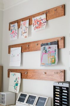 Children's art gallery in the playroom or bedroom to display your kid's art on the wall. This easy storage and organization project takes a few minutes and very few supplies.