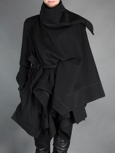 Ann Demeulemeester  __ asymmetric long draped wool jacket with detachable high collar & belt closure.