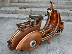 Scooter fans should start sharpening their chisels if they want to undertake this project. This Vespa is the work of a master carpenter and a lot of time. Through the build log photos you can see t...
