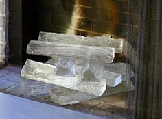 Glass fireplace logs! This is so cool! It would give a nice feel in Summer.