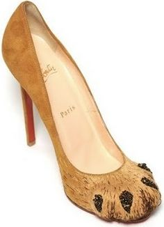 "Celebrity footwear designer Christian Louboutin has included these slightly bizarre lion paw pumps, puzzlingly called ""Alex,"" as part of his Fall 2011 collection."