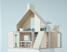 Aesthetically pleasing doll houses made from wood. Finally.