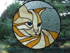 Beautiful Stained Glass Cat Panel. $85.00, via Etsy.