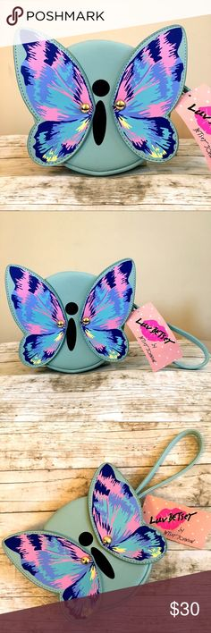 """Betsey Johnson Butterfly 🦋 Design Wristlet Wallet Luv Betsey by Betsey Johnson Butterfly 🦋 Design Wristlet Wallet • Zippered closure • Wristlet strap handle - 6"""" length  • Signature Butterfly 🦋 design in front part, wings are movable  • Cute design lining  • Comes from a smoke and pet free home • Bundle & Save 💰  Thank you for your interest, please don't forget to check out other items in my closet!! 😀🌷🙏🏼 Betsey Johnson Bags Clutches & Wristlets"""
