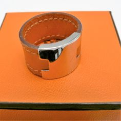 """Authentic Hermes Ring """"H"""" Orange Leather and Silver Tone with Pouch and Box - Unisex"""
