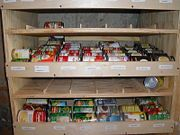 How to Build a Rotating Canned Food Shelf. Storing canned food in your kitchen cabinets is an inefficient use of space and you will often find old cans in the back. This easy-to-build shelf system will solve the problem by rotating the. Food Storage Shelves, Food Shelf, Canned Food Storage, Can Storage, Built In Shelves, Storage Ideas, Organization Ideas, Build Shelves, Storage Rack