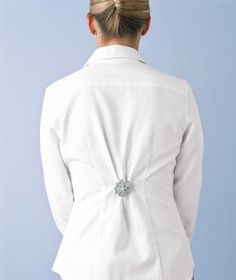 Adjust the fit of—and add a touch of sparkle to—a loose blouse or shirt by pinning it in back with a brooch.