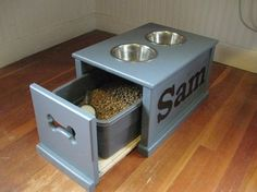 Personalized Dog Feeding Station. Raised feeding station making it easier for dogs to access & aids with digestion. Comes with 2 stainless steel bowls, 1 stainless steel scoop & a plastic container that holds about 3 lbs. of kibble. Station has room below bowls to store extra food.