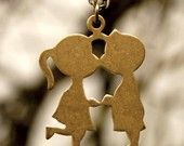 Boy and Girl Kissing 1960s Necklace. Had forgotten all about these, but do remember