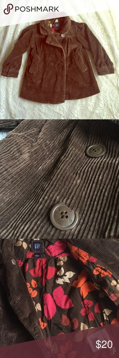 baby GAP kids corduroy coat Super adorable brown corduroy coat lined with a fall colored woodland patterned 100% cotton lining. My daughter never wore because she didn't like the color :( the only flaw is that a piece of the bottom broke off in the shuffle. Otherwise like new condition! GAP Jackets & Coats