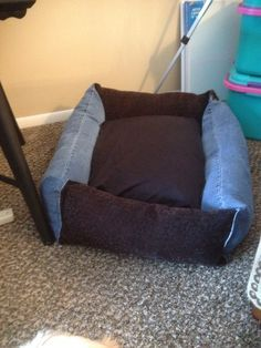 Dog bed made with blue jean legs and left over material from an upholstery project. A pillow and case for the middle for easy washing.