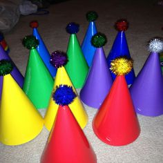 Hot glue, Pom poms and party hats for a circus themed party!