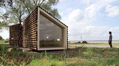 maison rondins de bois mur en verre