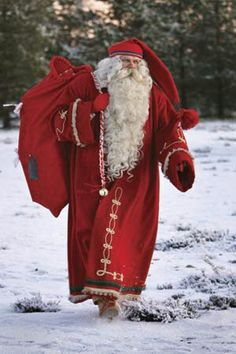 """Santa Claus, dressed in a traditional Finnish costume, totes a bag of toys in Rovaniemi, Finland. ~~~ although this says """"traditional Finnish costume"""", the Joulupukki I grew up knowing was dressed in dark colours. Noel Christmas, Father Christmas, Little Christmas, All Things Christmas, Christmas And New Year, Winter Christmas, Vintage Christmas, Christmas Scenes, Thanksgiving Holiday"""
