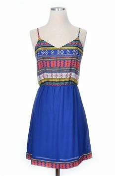 Our Meet Me In Madrid Dress is fun and flirty! A fit and flair dress with a patterned top and solid skirt. Summer wedges and statement earrings will compliment this amazing dress to a tee!