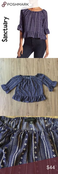 """🐾Sale! 🐾NWT Sanctuary Julia white, navy boho Pair with your favorite dark wash jeans for a classy boho look.  🐾 Off-the-shoulder 🐾 3/4 length sleeves with ruffle cuffs 🐾 Slips on over head 🐾 Crepe construction 🐾 Allover print 🐾 Ruffle hem 🐾 Bust: 19"""" approx. 🐾 Length: 20 1/2"""" approx. 🐾 Sleeve: 16"""" approx. 🐾 100% polyester 🐾 Machine wash, dry flat 🐾 New in bag  🐾 Bundle discount 🐾 No trades 🐾 Smoke free, pet friendly home Sanctuary Tops"""