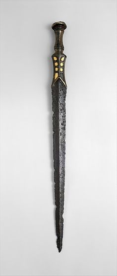 A fabled sword from the human county across the Rubicon Ocean. It is hard to say where the story originates, though many agree on one point; the sword was birthed from flame, and stokes infernos wherever it goes. Swords And Daggers, Knives And Swords, Concept Weapons, Arm Armor, Fantasy Weapons, Katana, Firearms, Guns, Metal