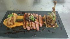 Pan fried duck breast and confit leg, rhubarb tart, kataifi confit leg, butternut squash puree and red wine jus.