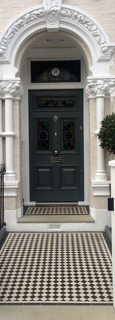 A Black door salutes this London front garden black and white victorian mosaic tile path yorkstone step Front Door Paint Colors, Painted Front Doors, Paint Colours, Victorian Front Doors, Victorian Homes, Victorian London, Victorian Mosaic Tile, Best Front Doors, London Townhouse