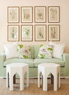 simple living room. love the green sofa with contrast piping