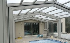 Attached Operable Single Peak swimming pool enclosure 22 ft wide x 30 ft long with 4 bays, 3 of them sliding away from a 1 ft attachment at the house coming to rest under the 4th fixed end bay, includes automatic electric drive system, 2 sliding doors and 2 windows with flyscreens, radiant in floor and space heating systems.
