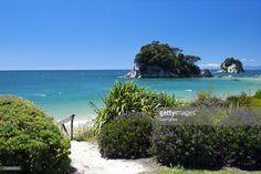Looking across Little Kaiteriteri Beach's still waters to Torlesse Rock, Kaiteriteri, Tasman Region, New Zealand in summer. New Zealand, Wordpress, River, Stock Photos, Rock, Beach, Summer, Photography, Outdoor