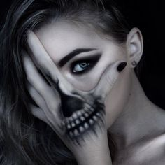 Skull makeup by Morganne Foster, a freelance makeup artist from New Zealand. More Halloween inspirations and designs at skullspiration.com