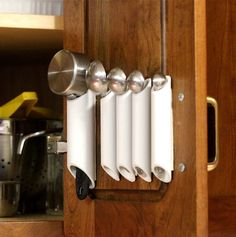 We have all seen the helpful DIY hook systems for inside cabinet doors for hanging measuring cup and spoon sets. In fact, back on January 4t...