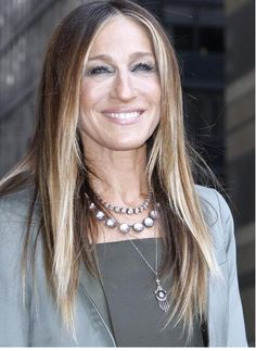 Sarah Jessica Parker wears Olivia Button rivière style sterling and white topaz with ballet foil ($5,400; larkspurandhawk.com) necjlace .  Satloff become a vintage jewelry dealer and then a designer in 2008. She revived the 18th century lost colored foil techniques for her handcrafted pieces of gems set in gold washed silver or oxidized silver.