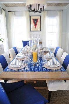 Neutral walls, curtains, furniture ... and the brilliant blue upholstery and table fabric really stands out. Decor by Phoebe Howard.