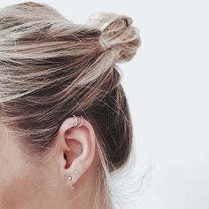 Dainty hoops and small studs around the ear