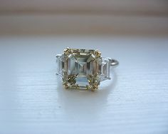 Light yellow 4.05ct Emerald cut diamond ring by Leon Megé  Luv this but would want middle smaller than this and sides a little bigger than this