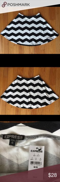 "NWT Express Black & White Chevron A-line Skirt Med New With Tag Express Chevron Fun And Flirty Skirt. No defects. Back Length: 19""; Front Length: 17"" Express Skirts A-Line or Full"
