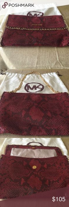 NWOT Michael Kors redblack purse  chain strap. Michael Kors redblack (Python) purse with detachable chain strap which converts bag into a clutch. New without tags (never worn) with dust bag. Michael Kors Bags Clutches  Wristlets