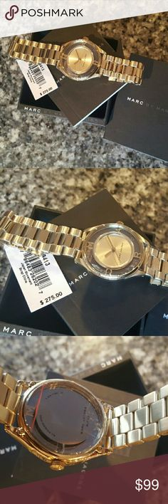 Marc Jacobs Gold Tether bracelet watch MJ3413 LAST 1! Guaranteed Authentic MJ3413 * Model: Tether * Retail: $275 * Gold stainless steel band. * Glam dial  * New with Marc Jacobs watch case and owners booklet included  * 36mm  * 5 ATM  * UPC: 796483262027 * WHAT A BEAUTY!  * No trades, buy now or offer only. Shipped same business day. Marc Jacobs Accessories Watches