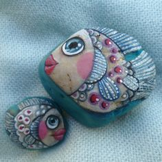PAINTED MOTHER AND BABY FISH ROCKS