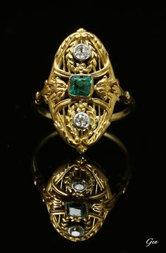 Emerald and Diamonds, gold openwork ring, France, ca. 1880-90, emerald, old European cut diamonds, 18ct gold and silver, bezel: 2.2 x 1.2 cm