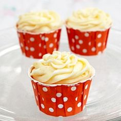 An orange-vanilla cupcake with orange cream cheese frosting and a surprise marshmallow fluff filling.  Tastes like a creamsicle!