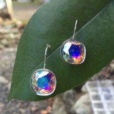"""Aurora borealis Swarovski earrings This is for a pair of brand new silver earrings with a 12mm Swarovski """"cushion"""" stone. Swarovski Jewelry Earrings"""