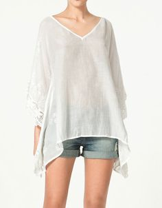 Blouse with embroidered sleeves