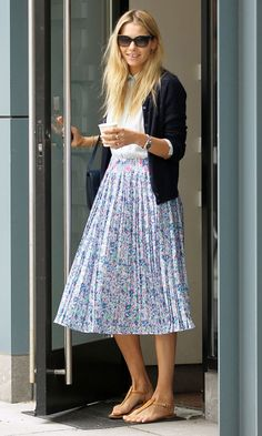 Jessica Hart keeping cool in a floral midi skirt out and about in New York