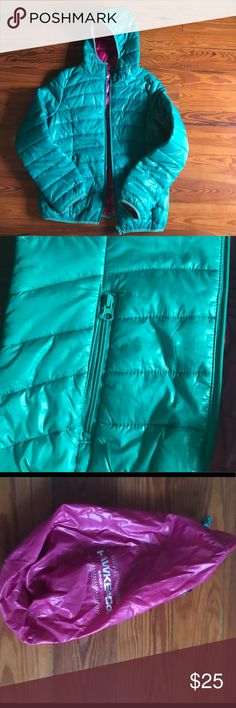 Puffer Jacket This is a really nice jacket in great condition and only worn twice. The color is green, although it looks blue I didn't have good lighting but it is green. The inside of the jacket is pink/purple. This jacket has two zipper pockets, Jodie, scrunching at the back waistband, and bag that the jacket can fit in. This fits a girls size L. Jackets & Coats Puffers