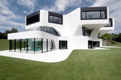 home › Architecture › Fantastic Modern Architecture Home Plans › Incredible Modern Architecture Home Plans With White Painted Unique Shape Wall Also Black Painted Stainless Steel Window And Door Frame Also Blue Tile Swimming Pool For Golf Field Home Resort Design ›